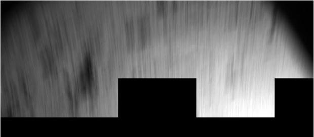 Cette image CIVA a été prise par CIVA juste après le 1er rebond alors que Philae était en mouvement, ce qui explique son aspect filé. Un traitement approprié devrait permettre de révéler quelques détails à la surface. Crédits : ESA/Rosetta/...