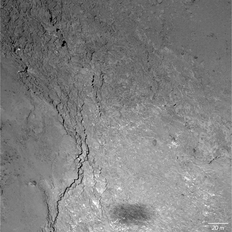 Close-up of the Imhotep region of comet 67P obtained by the OSIRIS-NAC camera on 14 February from an altitude of 6,000 m (11 cm/pixel); Rosetta's shadow is visible at the bottom of the image. Credits: ESA/Rosetta/MPS for OSIRIS Team MPS/UPD/LAM/IAA/...
